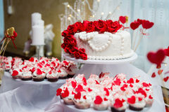 Wedding cake and cupcakes in decoration Stock Image