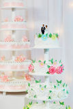 Wedding cake decorated with bride and groom figurines Stock Image
