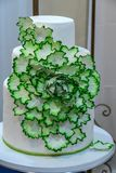 Wedding cake decorated with edible flowers stock photos