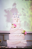Wedding cake decorated with flowers and a castle Stock Images