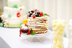 Wedding cake decorated with fruits Stock Photos