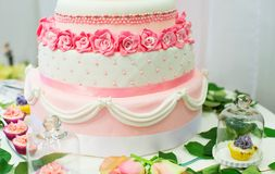 Wedding cake decorated with pink roses Stock Images