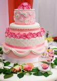 Wedding cake decorated with pink roses Stock Photos