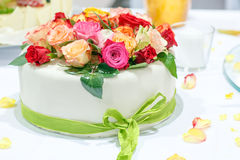 Wedding cake decorated with rose flowers. Royalty Free Stock Photo
