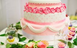 Wedding cake decorated with roses Stock Images