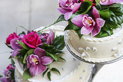 Wedding cake decorated with stunning orchids Royalty Free Stock Photos