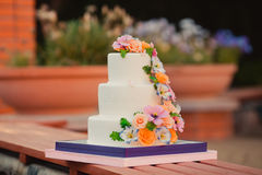 Wedding cake decorated with sugar flowers. Wedding cake decorated with flowers in purple color Royalty Free Stock Photo