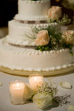 Wedding cake on the decorated table. Candles against a wedding cake on the table Royalty Free Stock Photo