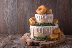 Wedding Cake Decorated With Donuts And Wild Berries. Stock Photos