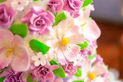 Wedding cake decoration. beautiful wedding cake with purple orchids. cake in violet tones. Cake decoration. beautiful wedding cake with purple orchids. cake in stock photography