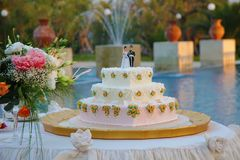 Wedding cake with the decoration of the bride and groom on top Royalty Free Stock Photography