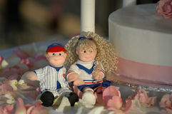 Wedding Cake decorations. Cute Wedding Cake decorations on side of cake Royalty Free Stock Image