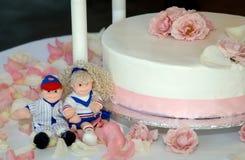 Wedding Cake decorations. Cute Wedding Cake decorations on side of cake Royalty Free Stock Photos