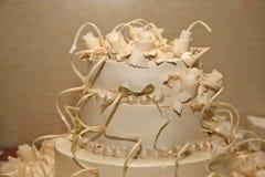 Wedding cake with decorative roses closeup Stock Photos