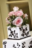 Wedding Cake detail. A wedding cake with pink roses royalty free stock photos