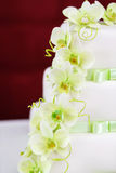 Wedding cake detail with orchid flowers Stock Photos