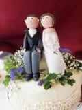 Wedding Cake Dollies. Bride & Bridegroom dollies on a wedding cake Royalty Free Stock Image