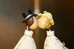 Wedding cake dolls kissing. Each other Royalty Free Stock Image
