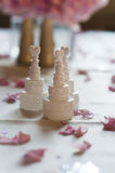 Wedding cake favours. Arranged on a table with flower petals Stock Photography