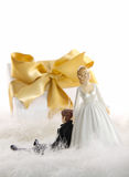 Wedding cake figures with gift on white. Wedding cake figures with gold ribbon gift on white Stock Images
