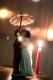 Wedding cake figures. Picture of Wedding cake figures with bokeh effect stock photo