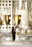 Wedding cake figurines on dinner plate Royalty Free Stock Photo