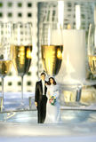 Wedding cake figurines on dinner plate Royalty Free Stock Photography