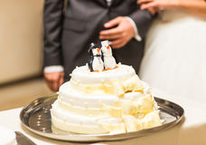 Wedding cake with figurines of penguins at the top Royalty Free Stock Photography