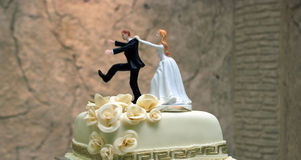 Wedding cake with figurines. Picture of a Wedding cake with figurines Royalty Free Stock Images