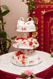 Wedding cake with figurines. Roses and swan Stock Images