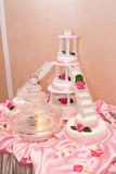 Wedding cake with figurines. Roses and waterfall Stock Image