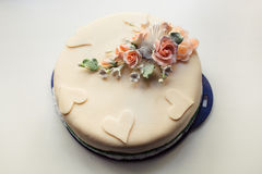 Wedding cake with flower and heart Stock Photos