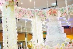 wedding cake on flower near wedding fair. Royalty Free Stock Image