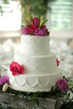 Wedding cake with flower topper Stock Photography