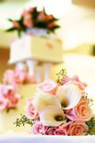 Wedding cake and flowers. A beautiful color palete: pink and white wedding accessories (flowers and cake Royalty Free Stock Photography