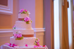 Wedding cake with flowers Royalty Free Stock Photo