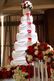 Wedding cake with flowers and seven tiers Stock Photos