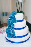 Wedding cake with flowers yellow beige  blue royalty free stock image