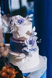 Wedding cake with flowers yellow beige red  blue royalty free stock photography