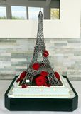 Wedding cake as eiffel tower with red roses stock photos