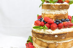Wedding cake with fruit. Wedding cake with open biscuit shortcakes, cream and fruit. blueberries, strawberries, raspberries, red currants stock photography