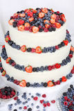 Wedding cake with fruits on white background Royalty Free Stock Images
