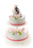 Wedding cake with girl and boy figurines Royalty Free Stock Photos