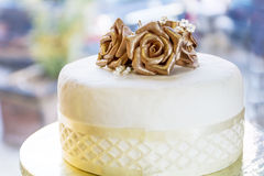 Wedding cake with golden roses Stock Photography