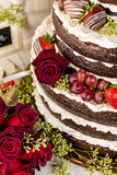 Wedding cake. Gourmet tiered wedding cake at wedding reception royalty free stock photo
