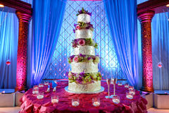 Wedding cake at Indian wedding. Image of a tall tiered wedding cake at Indian wedding stock images