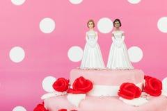 Wedding cake with lesbian couple stock image