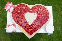 Wedding cake like a heart. A Strawberry wedding cake in heart form stock photos