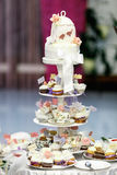 A wedding cake made of many little cupcakes Stock Image