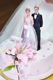 Wedding cake with models of bride and groom Royalty Free Stock Photo